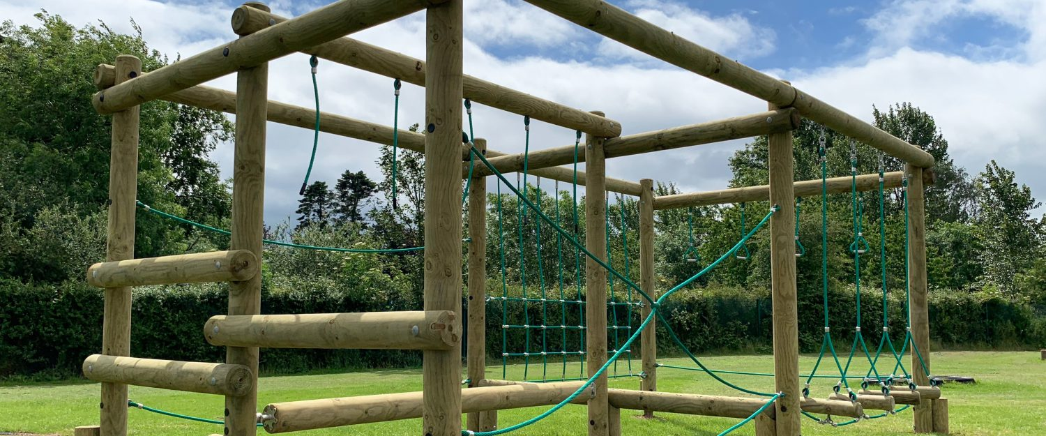 Timber play frame with netting and obstacle course, challenging stimulating play for all spaces