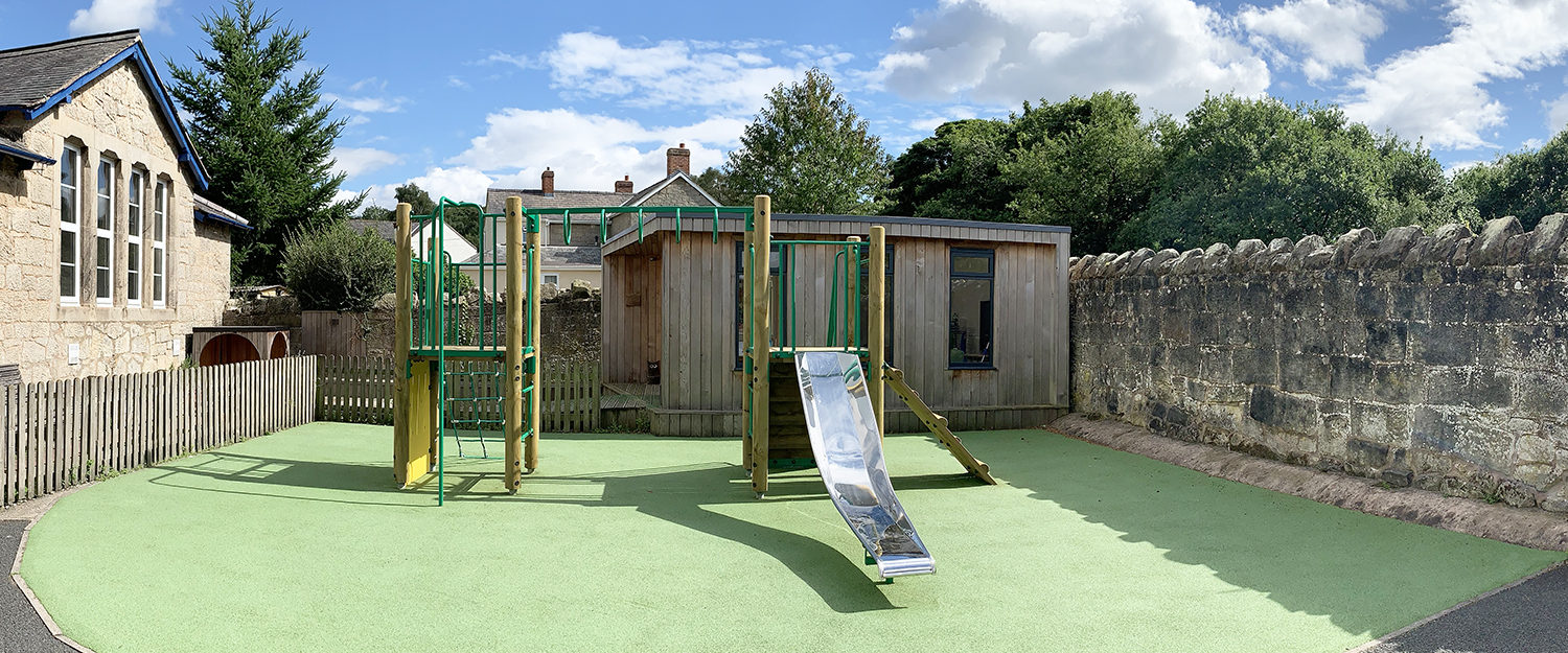 Clive School timber multiplay climber on green wetpour safer surfacing