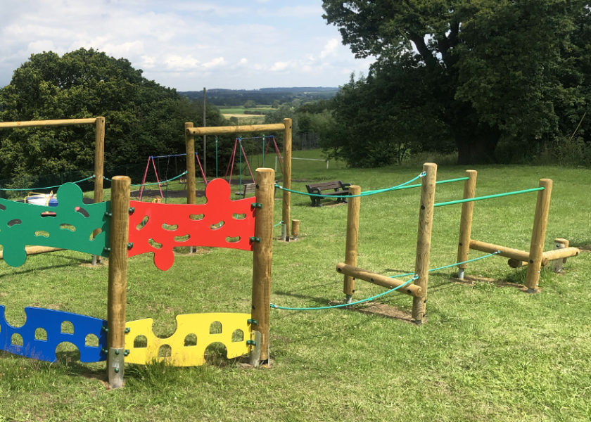 Adventure Trail at Bausley with Criggion, timber play equipment on grass